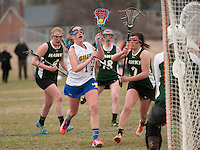 Gilford's Alex Harris gets past Hopkinton's Tess Masci for a shot to goal during Friday's NHIAA Division III Lacrosse at Gilford Meadows Field.  (Karen Bobotas/for the Laconia Daily Sun)