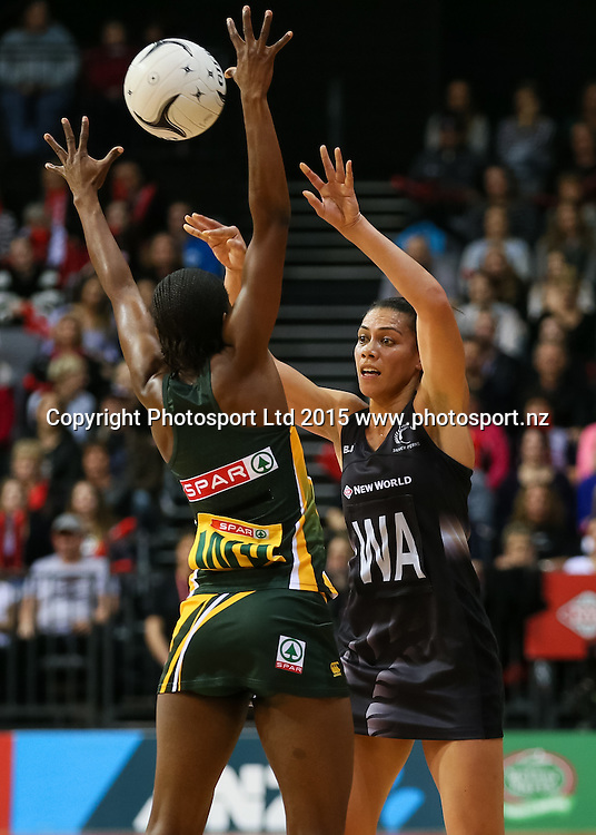 Silver Fern's Grace Rasmussen fires a pass past Spar Protea's Precious Mthembu during the international Netball match - Silver Ferns v South Africa at Claudelands Arena, Hamilton on Sunday 26 July 2015.  Copyright Photo:  Bruce Lim / www.photosport.nz