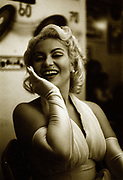 Woman dressed as Marilyn Monroe, striking a pose, Brazil