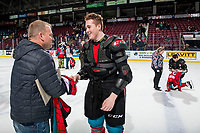 KELOWNA, CANADA - MARCH 16: Cayde Augustine #5 of the Kelowna Rockets meets the fan who won his jersey on March 16, 2019 at Prospera Place in Kelowna, British Columbia, Canada.  (Photo by Marissa Baecker/Shoot the Breeze)