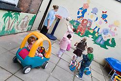 Group of playschool children having fun at breaktime,