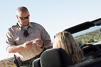 Woman Receiving Speeding Ticket