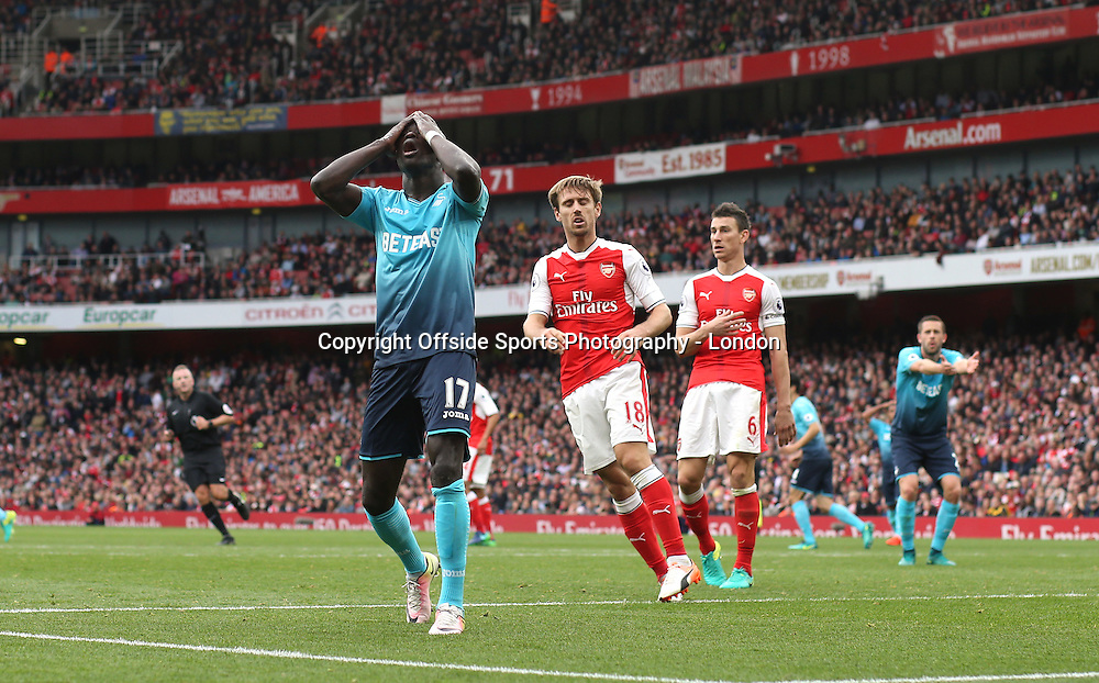 15 October 2016 London : Premier League Football - Arsenal v Swansea City :<br /> Modou Barrow of Swansea holds his head in his hands after missing a late chance of a goal.<br /> Photo: Mark Leech