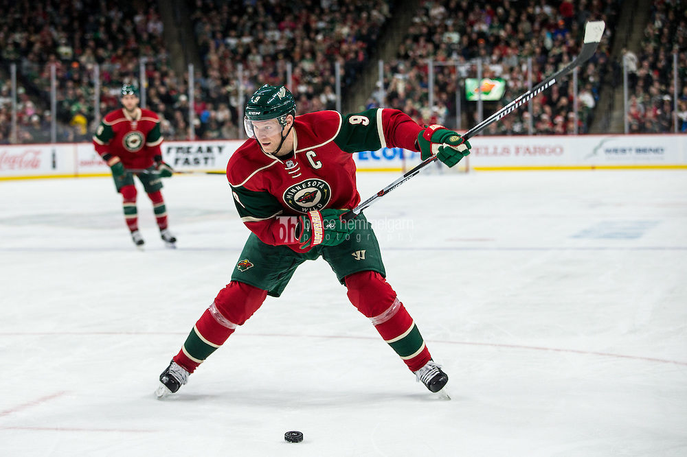 Dec 17, 2016; Saint Paul, MN, USA; Minnesota Wild forward Mikko Koivu (9) against the Arizona Coyotes at Xcel Energy Center. The Wild defeated the Coyotes 4-1. Mandatory Credit: Brace Hemmelgarn-USA TODAY Sports