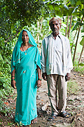 An MSS farming trainer and her husband pose for a picture near the village of Bagabar, Maharai District, India. Manav Seva Sansthan, MSS train farmers in the area in organic techniques as many cannot afford expensive fertilizers. The work with the local government negotiating land for Dalit farmers to use.
