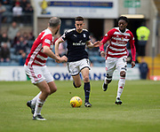 5th May 2018, Dens Park, Dundee, Scotland; Scottish Premier League football, Dundee versus Hamilton Academical; Cammy Kerr of Dundee takes on Rakish Bingham and Dougie Imrie of Hamilton Academical