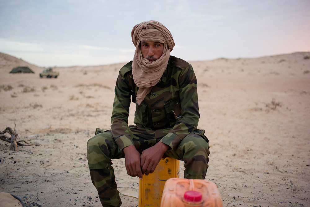 Western sahara/Guerguerat 2016-10-17<br /> Chokhan Bala, 26, from the refugee camp of Dakhla outside Tindouf, has been a soldier for nine years. He has been stationed in the Guerguerat area for a month. A couple of hundred heavily armed Polisario soldiers have been sent to the area since the situation began deteriorating on August 14th