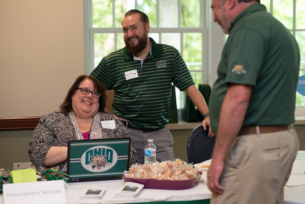 Diana McGew, Assistant Director of Strategic Sourcing and Operations for Procurement Services, left, and Richie Dillinger, <br /> Interim Contract Coordinator speak to someone at the Procurement Services booth at the Campus Communicator Network Expo in Nelson Commons on Wednesday, May 11, 2016. © Ohio University / Photo by Kaitlin Owens