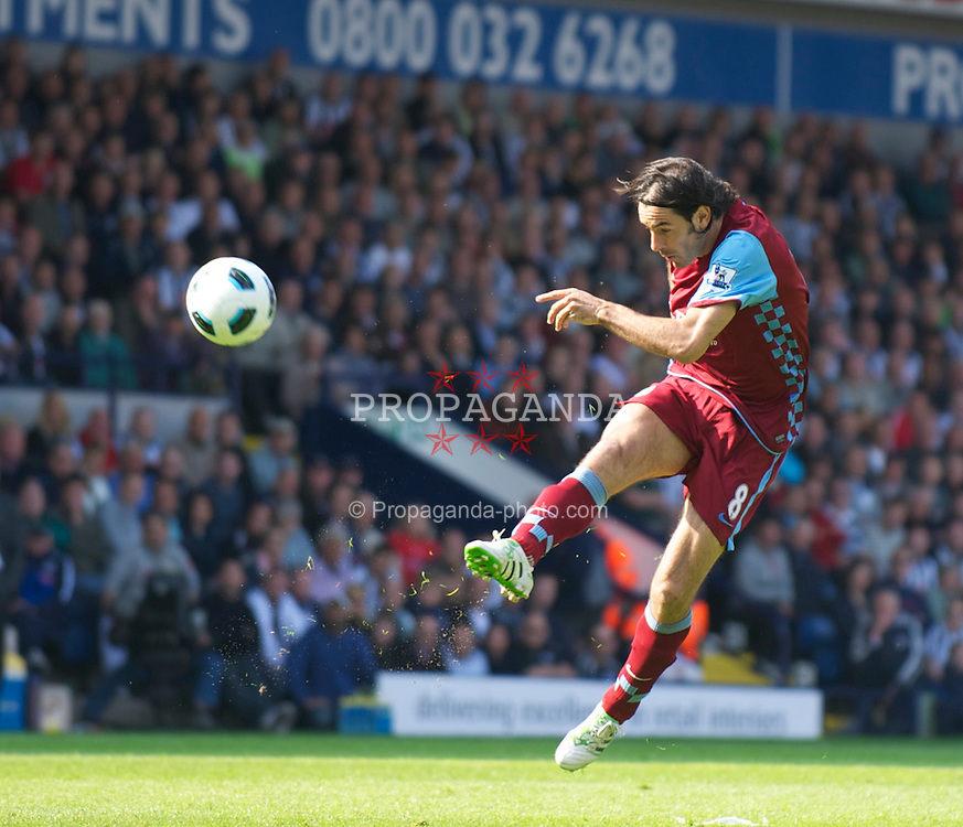 WEST BROMWICH, ENGLAND - Saturday, April 30, 2011: Aston Villa's Robert Pires shoots against West Bromwich Albion during the Premiership match at the Hawthorns. (Photo by David Rawcliffe/Propaganda)