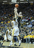 December 28, 2011: Purdue Boilermakers forward Robbie Hummel (4) puts up a shot over Iowa Hawkeyes guard/forward Eric May (25) during the NCAA basketball game between the Purdue Boilermakers and the Iowa Hawkeyes at Carver-Hawkeye Arena in Iowa City, Iowa on Wednesday, December 28, 2011. Purdue defeated Iowa 79-76.