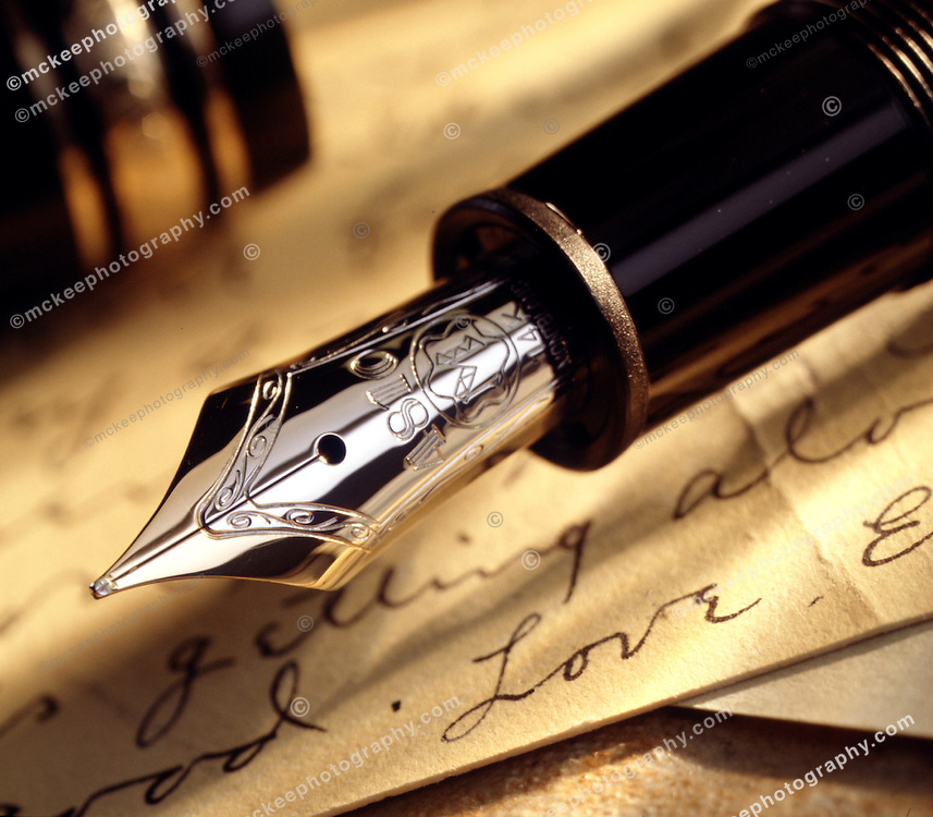 Fountain pen over a love letter