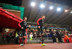 STOKE-ON-TRENT, ENGLAND - Tuesday, January 5, 2016: Liverpool's Joe Allen and Adam Lallana run out to warm-up before the Football League Cup Semi-Final 1st Leg match against Stoke City at the Britannia Stadium. (Pic by David Rawcliffe/Propaganda)
