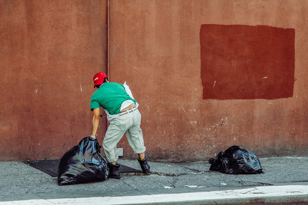 Restaurant worker taking out trash. NYC 2012
