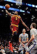 Cleveland Cavaliers' Dion Waiters (3) drives the ball to the basket over <br /> Brooklyn Nets' Shaun Livingston (14) and  Mirza Teletovic (33) during an NBA basketball game on Friday, March 28, 2014 at Barclays Center in New York. (AP Photo/Kathy Kmonicek)