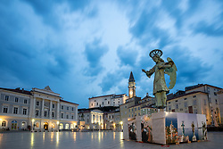 After two months of restoration, the Statue of Archangel Michael, made of copper plate, returned to Piran. The image shows a view of the statue of Archangel Michael and St. George's Parish Church from Tartini square before helicopter placing it on top of the church's clock, on October 15, 2018 in Piran, Slovenia. Photo by Matic Klansek Velej / Sportida