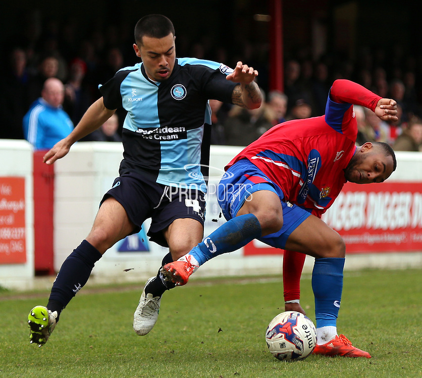 Nico Yennaris getting tackled during a Wycombe attack during the Sky Bet League 2 match between Dagenham and Redbridge and Wycombe Wanderers at the London Borough of Barking and Dagenham Stadium, London, England on 28 March 2015. Photo by Matthew Redman.