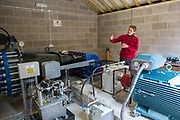 The hydro energy production room explained by Mary of Energy Local Bethesda, North Wales. © Andy Aitchison / Ashden