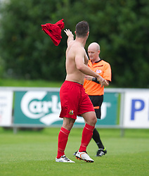 LLANELLI, WALES - Saturday, September 15, 2012: Llanelli's Luke Bowen throws his shirt away after being shown the red card and sent off by referee A.P. Harms during his side's 3-0 defeat by Newtown during the Welsh Premier League match at Stebonheath Park. (Pic by David Rawcliffe/Propaganda)