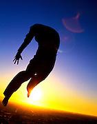A Dancer Jumping At Sunset