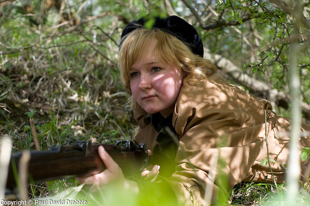 Female reenactor from Northern World War Two Association, portraying the French Resistance waits to ambush German troops during a private 24hr excerise.<br /> Sutton Grange, near Ripon Yorkshire 15  May 2010 .Images &copy; Paul David Drabble.