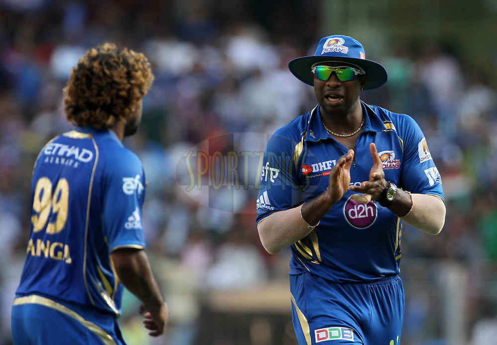 Lasith Malinga of the Mumbai Indians  and Kieron Pollard of the Mumbai Indians during match 22 of the Pepsi Indian Premier League Season 2014 between the Mumbai Indians and the Kings XI Punjab held at the Wankhede Cricket Stadium, Mumbai, India on the 3rd May  2014<br /> <br /> Photo by Vipin Pawar / IPL / SPORTZPICS<br /> <br /> <br /> <br /> Image use subject to terms and conditions which can be found here:  http://sportzpics.photoshelter.com/gallery/Pepsi-IPL-Image-terms-and-conditions/G00004VW1IVJ.gB0/C0000TScjhBM6ikg