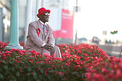 © Licensed to London News Pictures . 27/09/2015 . Brighton , UK . Labour Party activist JOSEPH AFRANE ( 51 from Battersea in London ) sits outside The Grand Hotel in the morning sun outside the Labour Party Conference . The 2015 Labour Party Conference . Photo credit : Joel Goodman/LNP