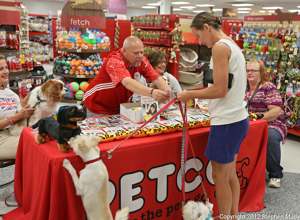 "Author Tony Nevett talks with Tomorra Wessel of Central City about his book, ""Danny goes to London"" at Petco, 1450 Twixt Town Road, in Marion on Saturday, August 4, 2012."