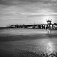 San Clemente pier sunset black and white photography. The sun was setting behind Lifeguard Tower Zero. Photo is high resolution. Copyright ⓒ 2017 Paul Velgos with All Rights Reserved.