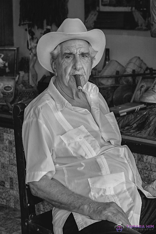 Cuban Man Smoking a Cigar in the Little Havana in 8th street. Miami. ©Tamara Him