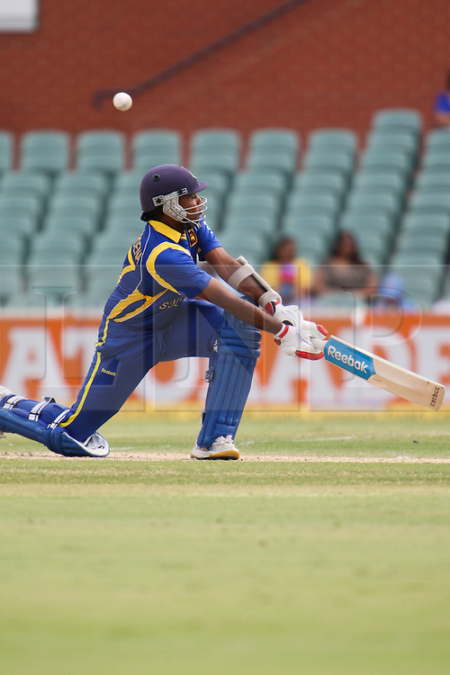 © Licensed to London News Pictures. 14/02/2012. Adelaide Oval, Australia. Sri Lankan batsman Mahela Jayawardena plays a sweep shot during the One Day International cricket match between India Vs Sri Lanka. Photo credit : Asanka Brendon Ratnayake/LNP