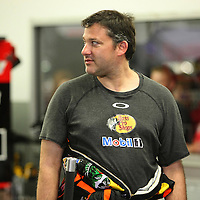 Tony Stewart walks in his garage area after the 56th Annual NASCAR Daytona 500 practice session at Daytona International Speedway on Wednesday, February 19, 2014 in Daytona Beach, Florida.  (AP Photo/Alex Menendez)