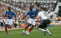 Photo: Steve Bond. <br />Derby County v Portsmouth. Barclays Premiership. 11/08/2007. John Utaka (C) attacks Derby defender Andy Griffin (R)