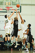 Vermont's Anthony Lamb (3) and Drew Urquhart (25) block the shot by Dartmouth's Evan Boudreaux (12) during the men's basketball game between the Dartmouth Big Green and the Vermont Catamounts at Patrick Gym on Wednesday December 7, 2016 in Burlington (BRIAN JENKINS/for the FREE PRESS)