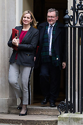 London, UK. 18th December, 2018. Amber Rudd MP, Secretary of State for Work and Pensions, and David Mundell MP, Secretary of State for Scotland, leave 10 Downing Street following the final Cabinet meeting before the Christmas recess. Topics discussed were expected to have included preparations for a 'No Deal' Brexit.