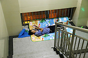 ZHENGZHOU, CHINA - (CHINA OUT) <br /> <br /> A Visit To The First Affiliated Hospital Of Zhengzhou University<br /> <br /> A relative of patient has a rest in a staircase at The First Affiliated Hospital of Zhengzhou University on July 3, 2015 in Zhengzhou, Henan Province of China. According to the offical data, The First Affiliated Hospital of Zhengzhou University has more than 7,000 beds, and more than 310,000 patients were hospitalized in the hospital last year, with the income of 7.5 billion yuan (1.2 billion USD). <br /> ©Exclusivepix Media