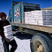 After three days of work Inocencio  Flores will have cut up to thousand blocks of salt that was going even colchani in his(her,your) truck.  Salar de Uyuni ( Uyuni salt flat ) . Department  of Potos&iacute;  ( Los Lipez).  South West  Bolivia. <br /> Adult Altiplano America Andes Arid  Aridity Axe Barren  Bicycle Block  Bolivia Cleaver Color Colour Cone  Day Daytime  Department  Desert Desolate Desolation Dry  Exterior Extraction  Geography Hack Hard Hatchet  Heat Highlands  Horizon Horizontal Human  Latin America Lake  Los Lipez  Lorry Male Man Men Miner Mining Nature  Resource  Natural  One Outdoors Outside  Pan People  Person Pyramide Potos&iacute;  Production  Region Resource Rural Salar de Uyuni  Salt Flat  Salt Pan  Salt lake  Scenic Seasoning  Single Shape South America  Southwest  Sud Sunglasses  Surface Travel Track West White Work  Worker Working