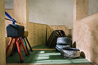 """NAPLES, ITALY - 16 MARCH 2018: Vault horses are seen here in the gym of """"Il Tappeto di Iqbal"""" (Iqbal's carpet), a non-profit cooperative in Barra, the estern district of Naples, Italy, on March 16th 2018.<br /> <br /> Il Tappeto di Iqbal (Iqbal's Carpet) is a non-profit cooperative founded in 2015 and Save The Children partner since 2015 that operates in the Naple's eastern neighborhood of Barra children in the arts of circus, theater and parkour. It was named after Iqbal Masih, a Pakistani boy who escaped from life as a child slave and became an activist against bonded labor in the 1990s.<br /> Barra, which is home to some 45,000 people, has the highest rate of school dropouts in the Italian region of Campania. Once a thriving industrial community, many of the factories were destroyed in a 1980 earthquake and never rebuilt. The resulting de-industrialization turned Barra into a poor, decaying neighborhood. There are no cinemas, theaters, parks or public spaces in Barra.<br /> The vast majority of children from poor families are faced with the choice of working in the black economy or joining the ranks of the organised crime.<br /> Recently, Save the Children Italy opened a number of educational and social spaces in Barra. The centers, known as Punti Luce, or points of light, aim to help local kids stay out of the ranks of the organised crime and have also become hubs for Iqbal's Carpet to work."""