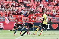 February 12, 2017: Western Sydney Wanderers Terry ANTONIS (24), Western Sydney Wanderers forward Jumpei (14) working to get past Central Coast Mariners defender Jake McGING (22) at Round 19 of the 2017 Hyundai A-League match, between Western Sydney Wanderers and Central Coast Mariners played at Spotless Stadium in Sydney.