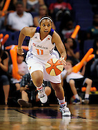 Sep 17 2011; Phoenix, AZ, USA; Phoenix Mercury guard Ketia Swanier (11) handles the ball on the court while playing against the Seattle Storm during the first half at the US Airways Center.  The Mercury defeated the Storm 92 - 83. Mandatory Credit: Jennifer Stewart-US PRESSWIRE