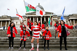 "© Licensed to London News Pictures. 29/09/2019. London, UK. Performers waves flags of Japan, England, Scotland and Wales on the steps of Trafalgar Square during the  annual Japan Matsuri festival of Japanese music, food and culture. The concept of the theme this year is ""Future generations"". Photo credit: Dinendra Haria/LNP"