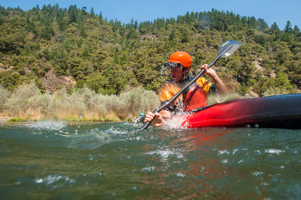 Eugene Buchanan paddling the Rogue River, Oregon.
