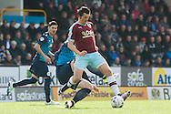 Joey Barton of Burnley is tackled from behind by Sebastian Polter of Queens Park Rangers during the Sky Bet Championship match at Turf Moor, Burnley<br /> Picture by Matt Wilkinson/Focus Images Ltd 07814 960751<br /> 02/05/2016