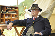 Old Bethpage, New York, USA - July 21, 2012: GUY SMITH of Huntington, NY, portrays Regimental Adjutant at Headquarters, at re-creation of Camp Scott, a Union Army training camp, at Old Bethpage Village Restoration, to commemorate 150th Anniversary of American Civil War, on Saturday, July 21, 2012.