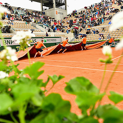 Groundstaff on Court Suzanne Lenglen bring the covers out as it starts to rain during Day 3 of the French Open 2018 on May 29, 2018 in Paris, France. (Photo by Dave Winter/Icon Sport)