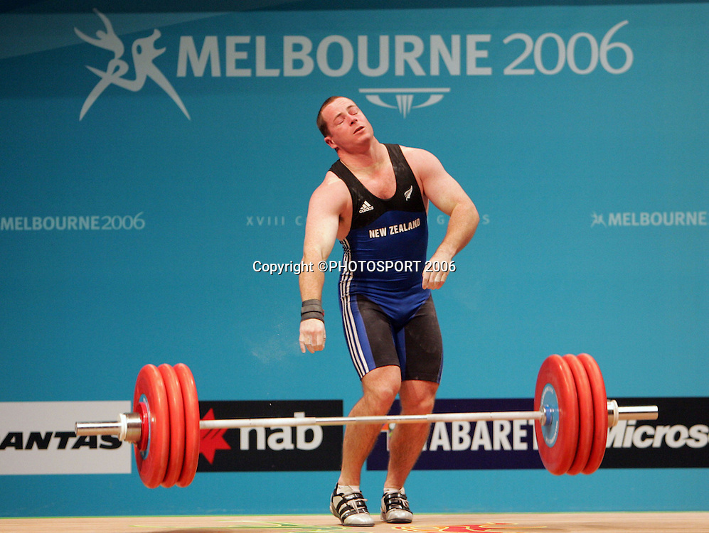 New Zealand's Grant Cavitt drops his weight during the Mens 94kg Weightlifting on day 6 of the XVIII Commonwealth Games, Melbourne, Australia, Tuesday, March 21 2006. Photo: Michael Bradley/PHOTOSPORT<br /> <br /> 210306 151414