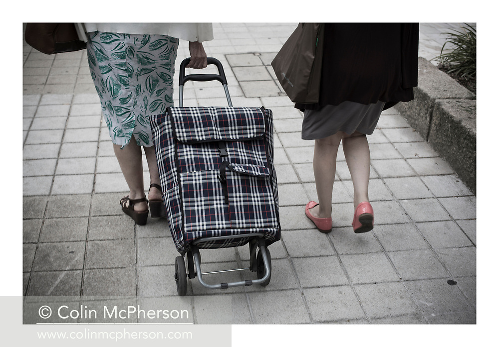 'Shopping in pink shoes, 2013', from 'The Recession Will Not Be Televised' by Colin McPherson, a body of photographic work which looks at the visual representation of the ongoing economic crisis in Porto, Portugal.<br />