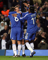 Photo: Paul Thomas.<br /> Chelsea v Levski Sofia. UEFA Champions League, Group A. 05/12/2006. <br /> <br /> Andriy Shevchenko (C) of Chelsea is congratulates after scoring by captain Frank Lampard (L) and Didier Drogba.