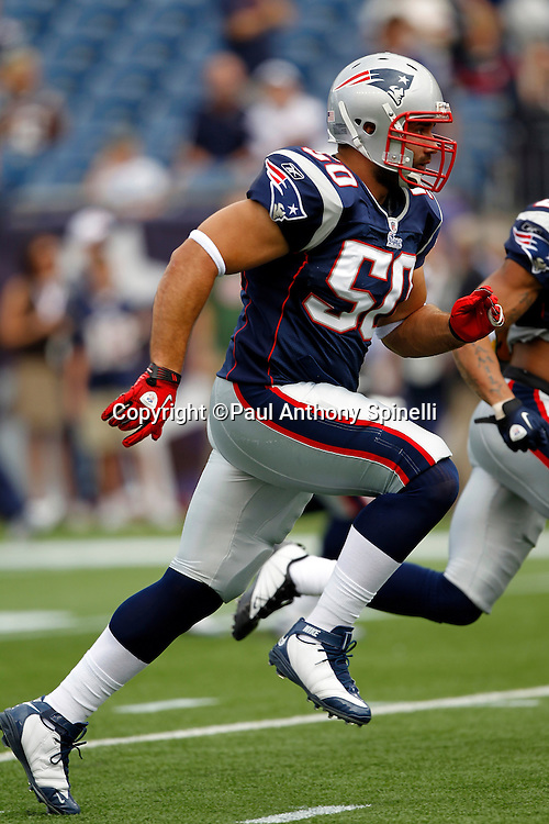New England Patriots linebacker Rob Ninkovich (50) runs downfield on special teams during the NFL regular season week 3 football game against the Buffalo Bills on September 26, 2010 in Foxborough, Massachusetts. The Patriots won the game 38-30. (©Paul Anthony Spinelli)