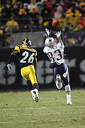 PITTSBURGH - JANUARY 23:  Wide receiver Deion Branch #83 of the New England Patriots catches a 60 yard touchdown pass in the first quarter while defended by cornerback Deshea Townsend #26 of the Pittsburgh Steelers during the AFC Championship game at Heinz Field on January 23, 2005 in Pittsburgh, Pennsylvania. The Pats defeated the Steelers 41-27. ©Paul Anthony Spinelli  *** Local Caption *** Deion Branch; Deshea Townsend