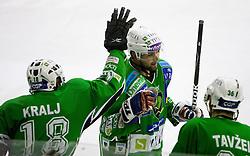 Jure Kralj of Tilia Olimpija and Travis Brigley of Tilia Olimpija at ice-hockey match in 33rd Round of EBEL league between HDD Tilia Olimpija Ljubljana and EC KAC, Klagenfurt, on December 18, 2009, in Arena Tivoli, Ljubljana, Slovenia. Olimpija defeated KAC 4:2. (Photo by Vid Ponikvar / Sportida)